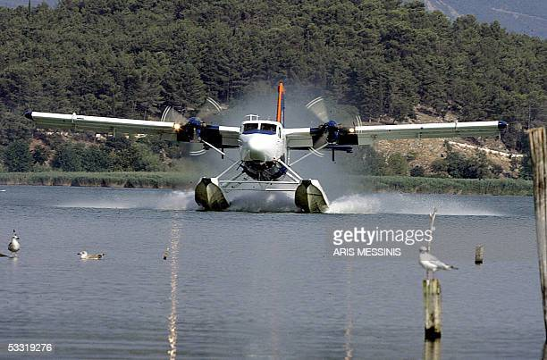 A twinengine De Havilland Otter seaplane lands in the Lake of Ioannina in northwestern Greece on 26 July 2005 Part of a new connection from the...