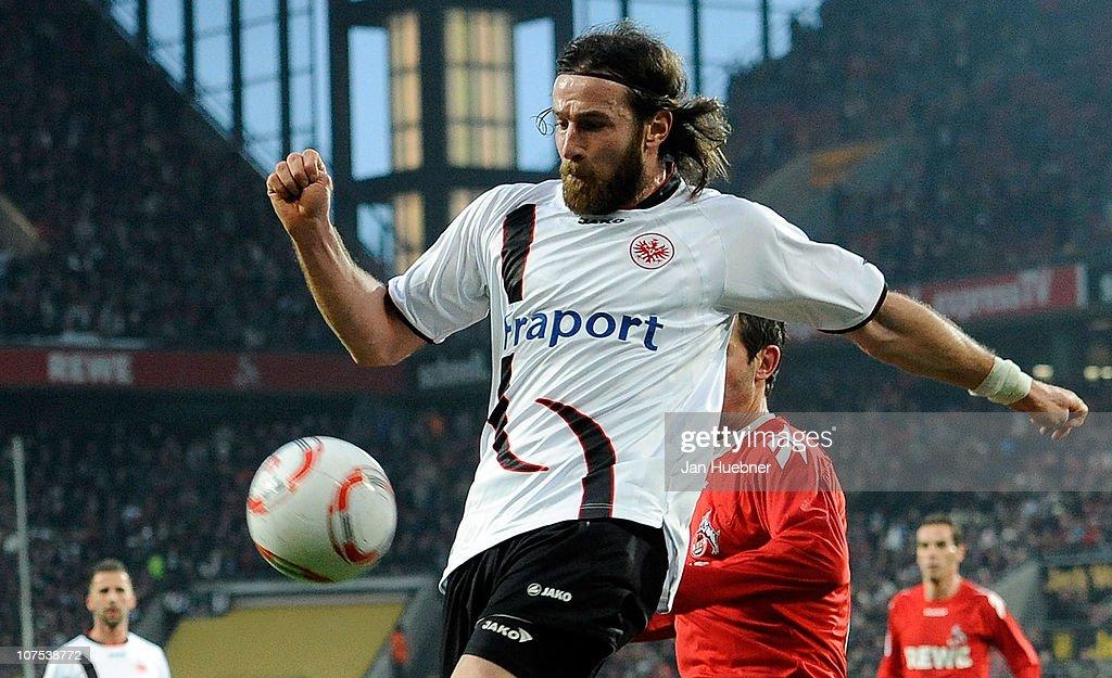 <a gi-track='captionPersonalityLinkClicked' href=/galleries/search?phrase=Ioannis+Amanatidis&family=editorial&specificpeople=616649 ng-click='$event.stopPropagation()'>Ioannis Amanatidis</a> of Eintracht Frankfurt and <a gi-track='captionPersonalityLinkClicked' href=/galleries/search?phrase=Fabrice+Ehret&family=editorial&specificpeople=754522 ng-click='$event.stopPropagation()'>Fabrice Ehret</a> of 1 FC Koeln battle for the ball during the Bundesliga match between 1.FC Koeln and Eintracht Frankfurt at RheinEnergie Stadium on December 11, 2010 in Cologne, Germany.