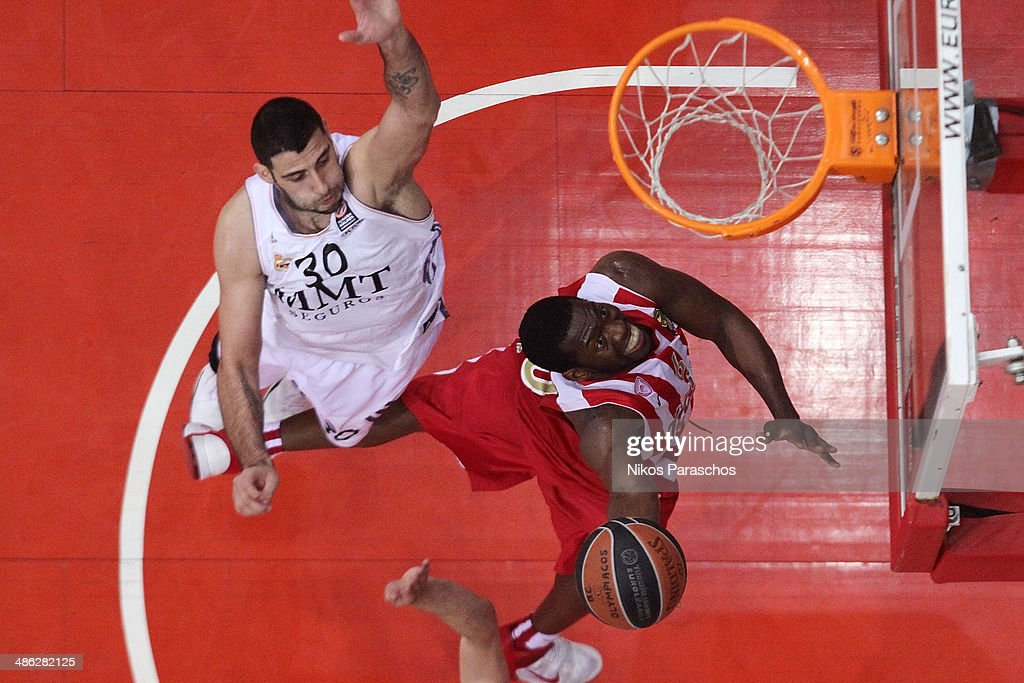 <a gi-track='captionPersonalityLinkClicked' href=/galleries/search?phrase=Ioannis+Bourousis&family=editorial&specificpeople=2114420 ng-click='$event.stopPropagation()'>Ioannis Bourousis</a>, #30 of Real Madrid competes with Bryant Dunston, #6 of Olympiacos Piraeus during the Turkish Airlines Euroleague Basketball Play Off Game 4 between Olympiacos Piraeus v Real Madrid at Peace and Friendship Stadium on April 23, 2014 in Athens, Greece.