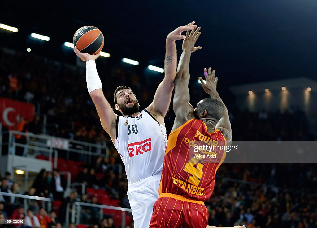 Ioannis Bourousis #30 of Real Madrid competes with Patric Young #4 of Galatasaray Liv Hospital Istanbul during the Turkish Airlines Euroleague...