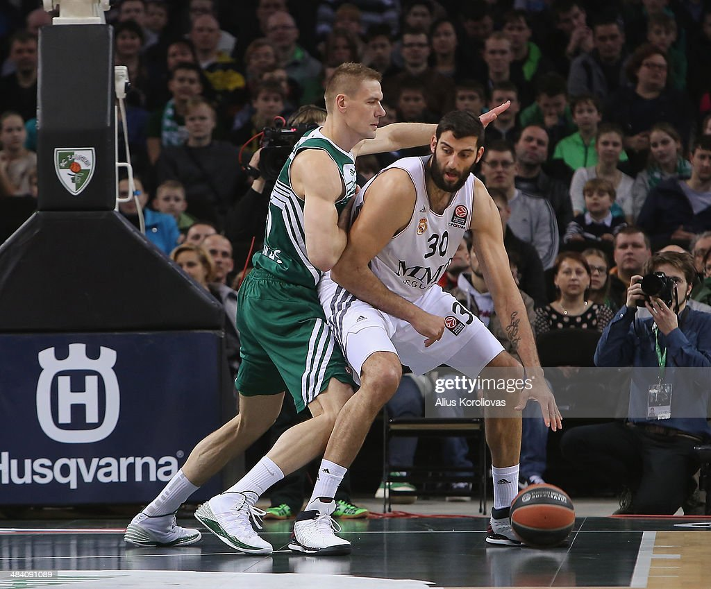 Ioannis Bourousis #30 of Real Madrid competes with Robertas Javtokas #15 of Zalgiris Kaunas in action during the 20132014 Turkish Airlines Euroleague...