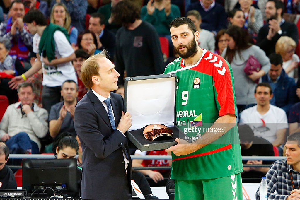 Ioannis Bourousis #9 of Laboral Kutxa Vitoria Gasteiz with the mvp trophy during the 20152016 Turkish Airlines Euroleague Basketball Playoffs Game 1...