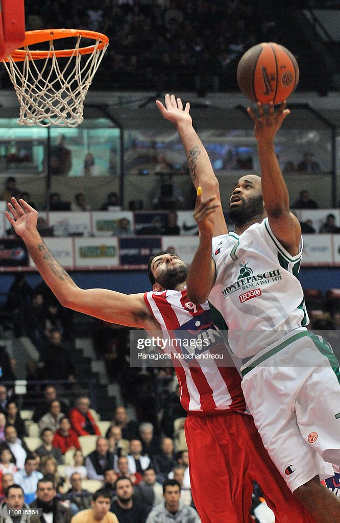 Ioannis Bourousis, #9 of Olympiacos Piraeus competes with Malik Hairston, #7 of Montepaschi Siena during the Play-Offs Date 2 game between Olympiacos Piraeus vs Montepaschi Siena at Peace and Friendship Stadium on March 24, 2011 in Athens, Greece.