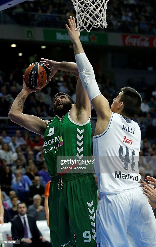 Ioannis Bourousis (L) of Laboral Kutxa Vitoria Gasteiz in action against Willy Hernan-Gomez of Real Madrid during the Turkish Airlines Euroleague Basketball Top 16 Round 6 game between Real Madrid v Laboral Kutxa Vitoria Gasteiz at Barclaycard Center on February 5, 2016 in Madrid, Spain.