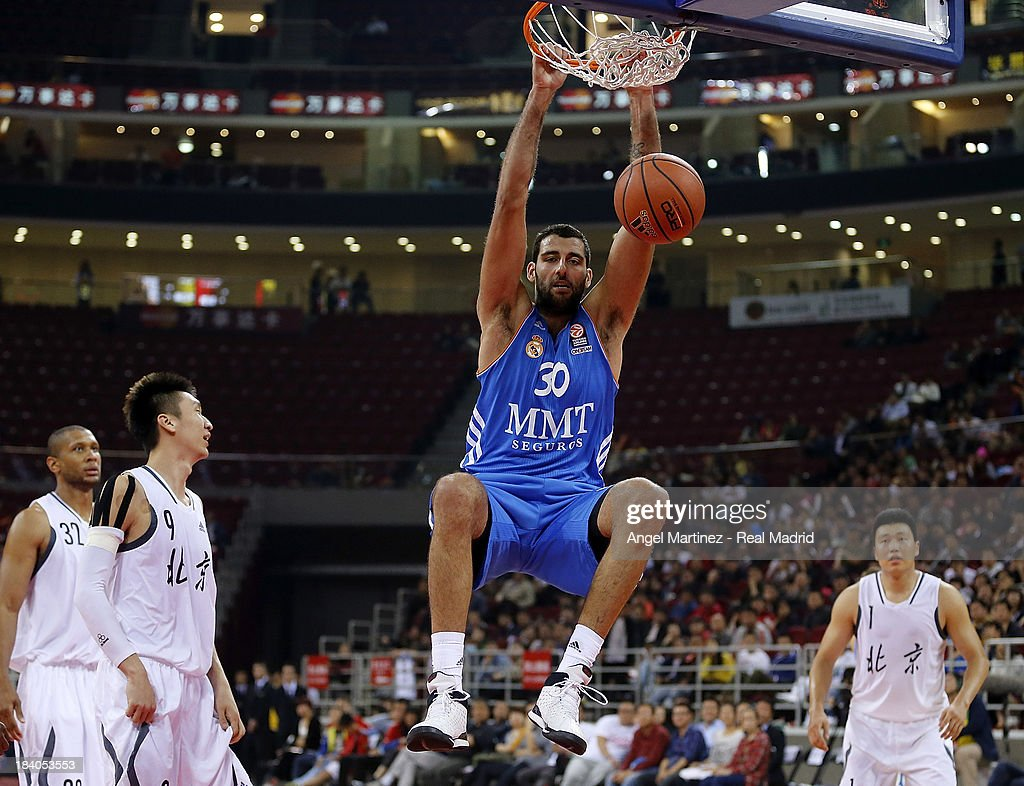 Ioannis Bourousis of Real Madrid dunks the ball during the Euroleague Basketball China Tour 2013 game against Beijing Ducks at MasterCard Center on...