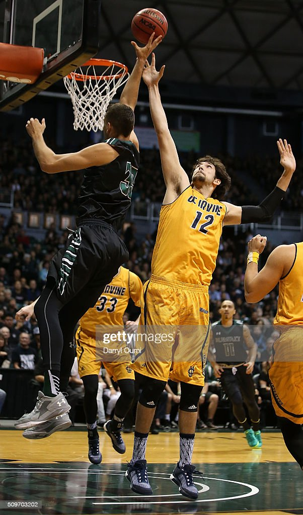 Ioannis Dimakopoulos #12 of the UC Irvine Anteaters tries to block the shot of Stefan Jankovic #33 of the Hawai'I Rainbow Warriors at Stan Sheriff Center on February 12, 2016 in Honolulu, Hawaii.