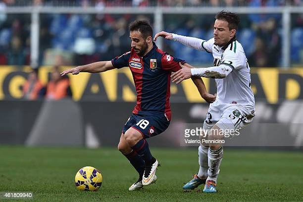 Ioannis Fetfatzidis of Genoa CFC is challenged by Matteo Brighi of US Sassuolo Calcio during the Serie A match between Genoa CFC and US Sassuolo...