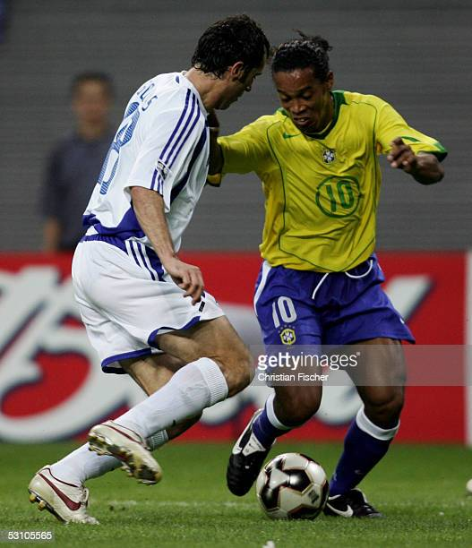 Ioannis Goumas of Greece and Ronaldinho of Brazil fight for the ball during the FIFA Confederations Cup 2005 Match between Brazil and Greece on June...