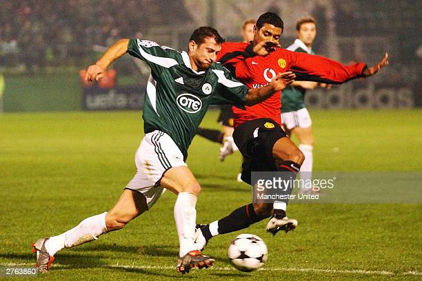 Ioannis Goumas of Panathinaikos takes on Kleberson of Manchester United during the UEFA Champions League match between Panathinaikos and Manchester...