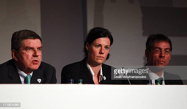 IOCMember Thomas Bach IOCMember Claudia Bokel and CEO Bernhard Schwank speak during the Munich 2018 Olympic Winter Games bid Press Conference held at...