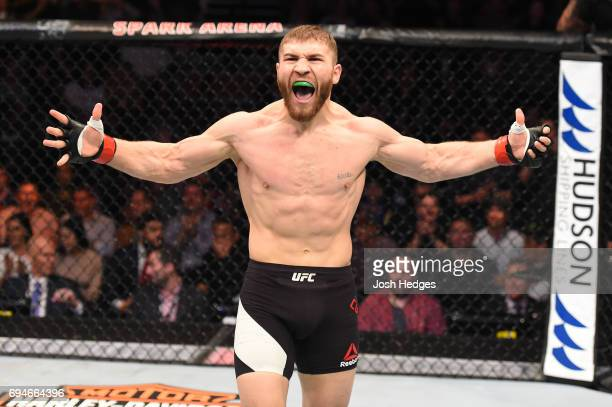 Ion Cutelaba of Moldova celebrates after defeating Henrique da Silva of Brazil in their light heavyweight fight during the UFC Fight Night event at...