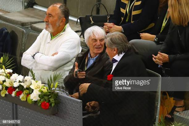 Ion iriac Bernie Ecclestone and Ilie Nastase look on during day six of the Mutua Madrid Open tennis at La Caja Magica on May 11 2017 in Madrid Spain