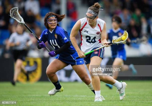 Iona Dryden of Great Britain is tracked by Kaho Inoue of Japan during the Lacrosse Women's match between Great Britain and Japan of The World Games...