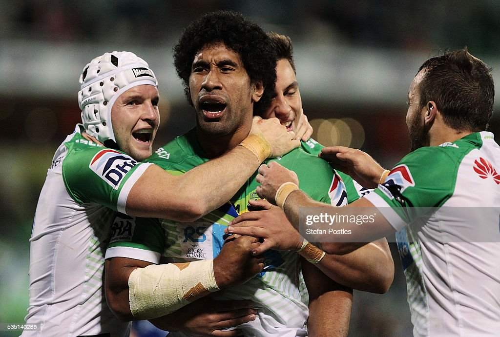 Iosia Soliola of the Raiders celebrates with team mates after scoring a try during the round 12 NRL match between the Canberra Raiders and the Canterbury Bulldogs at GIO Stadium on May 29, 2016 in Canberra, Australia.