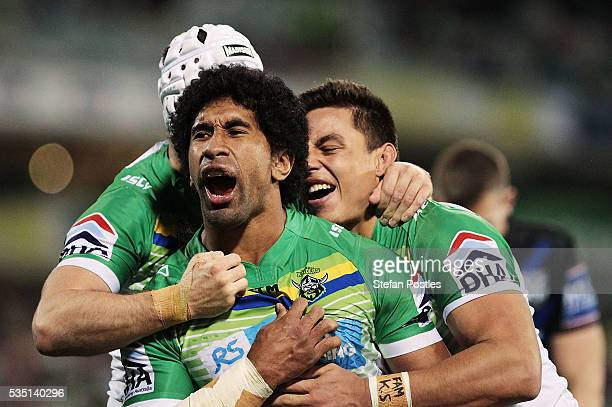 Iosia Soliola of the Raiders celebrates with team mates after scoring a try during the round 12 NRL match between the Canberra Raiders and the...