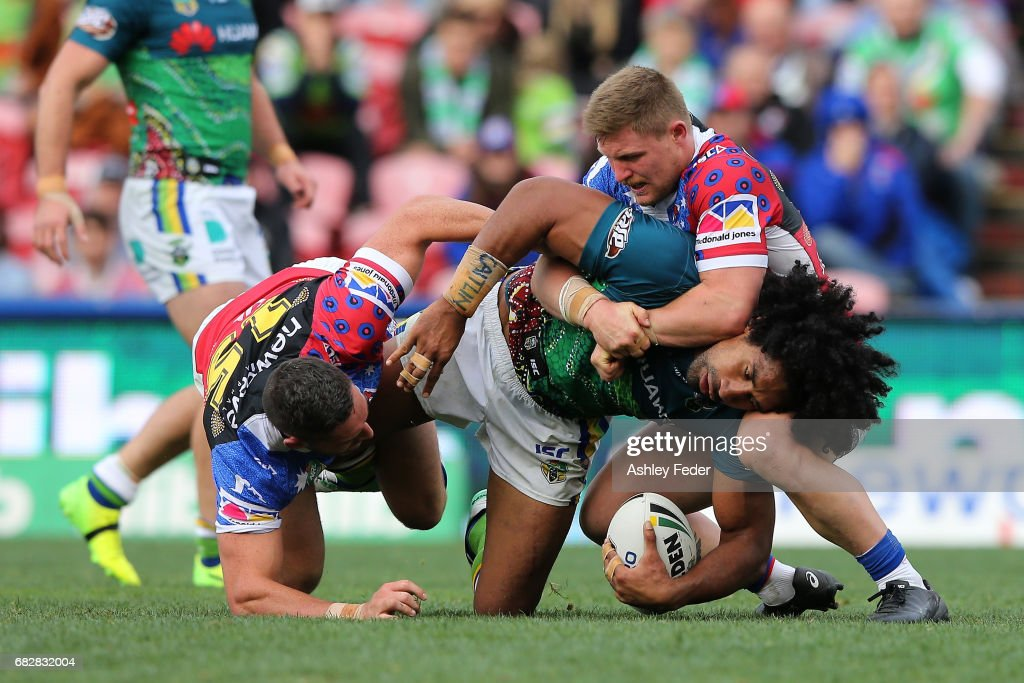Iosia Soliola of the Raiders is tackled by the Knights defence during the round 10 NRL match between the Newcastle Knights and the Canberra Raiders at McDonald Jones Stadium on May 14, 2017 in Newcastle, Australia.