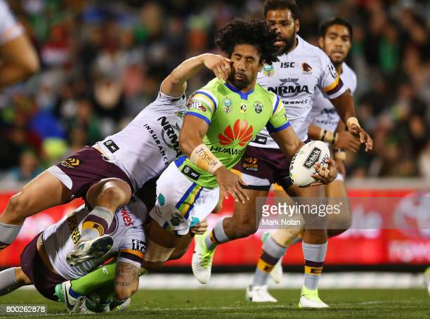 Iosia Soliola of the Raiders looks to offload during the round 16 NRL match between the Canberra Raiders and the Brisbane Broncos at GIO Stadium on...