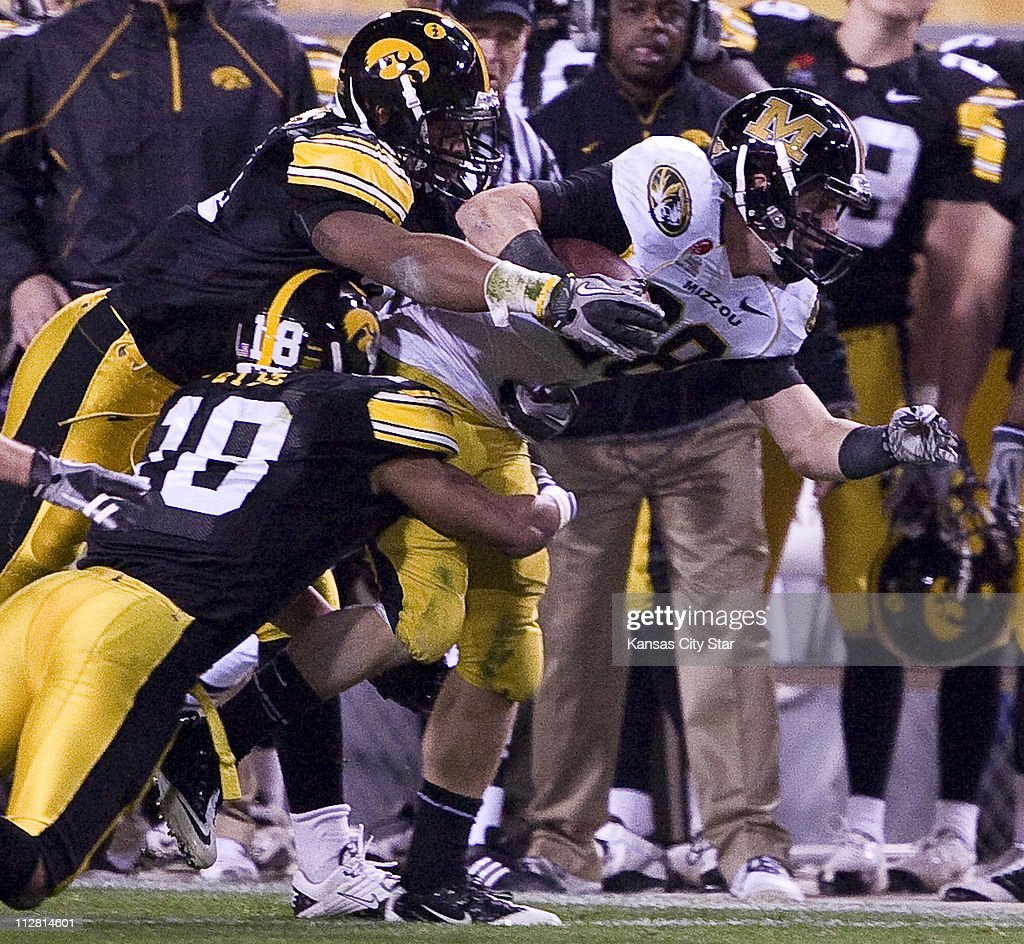 Iowa cornerbacks Anthony Hitchens 31 and Micah Hyde 18 drag
