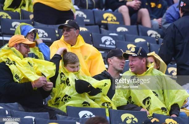 Iowa fans came prepared for wet weather during a Big Ten Conference football game between the Illinois Fighting Illini and the Iowa Hawkeyes on...