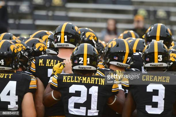 Iowa football players huddle up before a Big Ten Conference football game between the Illinois Fighting Illini and the Iowa Hawkeyes on October 07 at...