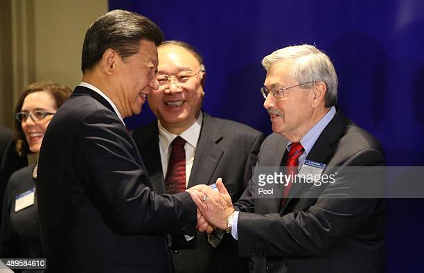 Iowa Gov Terry Branstad greets Chinese President Xi Jinping before a forum for US And Chinese governors September 22 2015 in Seattle Washington Xi is...