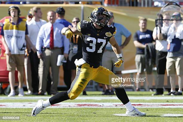 Iowa Hawkeyes defensive back Brandon Snyder celebrates after intercepting a pass in the 1st quarter of the 2017 Outback Bowl between the Florida...