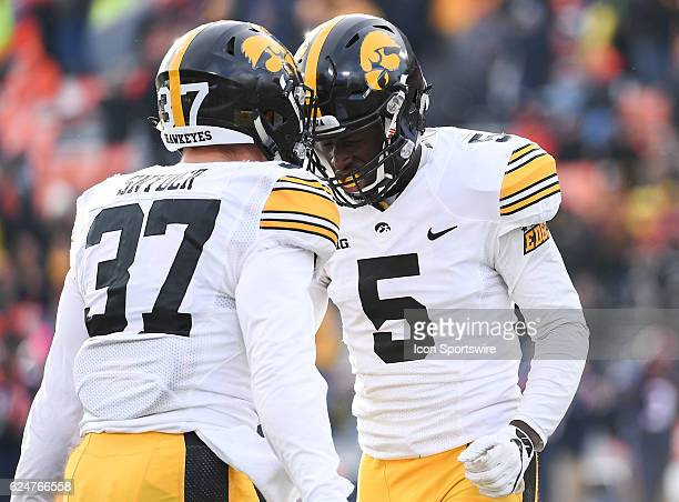 Iowa Hawkeyes defensive back Manny Rugamba and Iowa Hawkeyes defensive back Brandon Snyder celebrate the recovered fumble during the game between the...