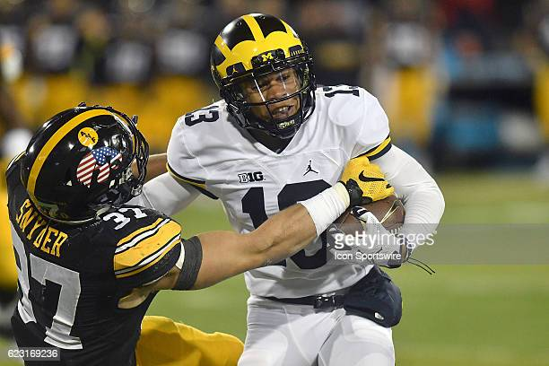Iowa Hawkeyes free safety Brandon Snyder tackles Michigan running back Eddie McDoom during a Big Ten Conference football game between the Michigan...