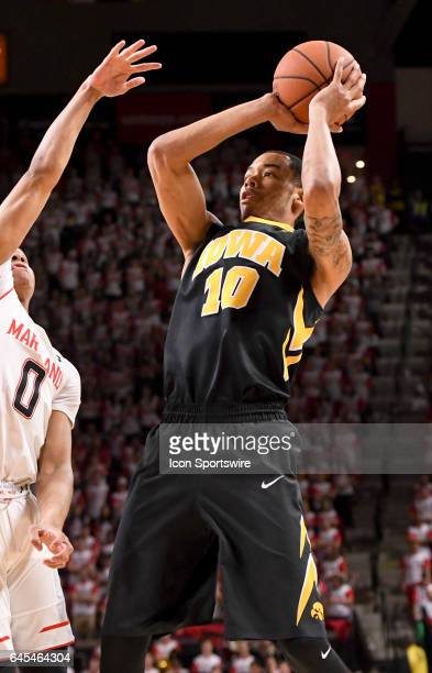 Iowa Hawkeyes guard Christian Williams scores in the first half against Maryland Terrapins guard Anthony Cowan on February 25 at Xfinity Center in...