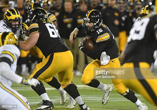 Iowa Hawkeyes quarterback CJ Beathard runs to the 15 yard line to set up a field goal during a Big Ten Conference football game between the Michigan...