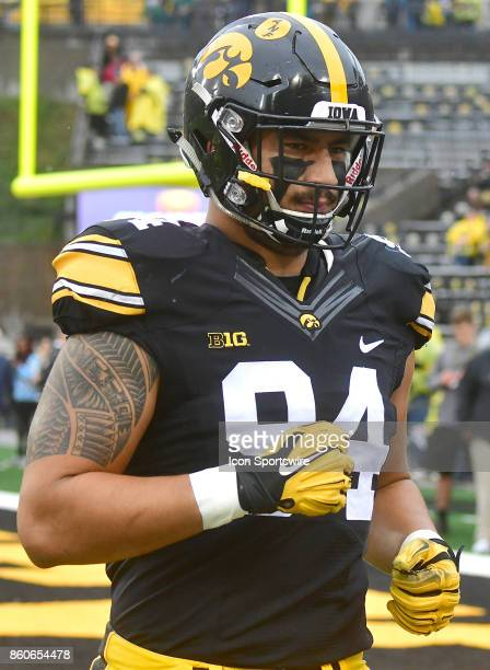 Iowa Hawkeyes' right end AJ Epenesa warms up before a Big Ten Conference football game between the Illinois Fighting Illini and the Iowa Hawkeyes on...