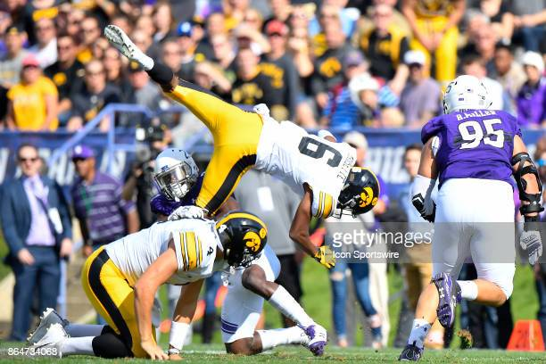 Iowa Hawkeyes wide receiver Ihmir SmithMarsette is upended by Northwestern Wildcats cornerback Montre Hartage during the game between the Iowa...