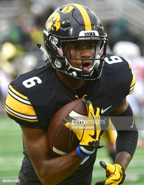 Iowa Hawkeyes' wide receiver Ihmire SmithMarsette warms up before a Big Ten Conference football game between the Illinois Fighting Illini and the...