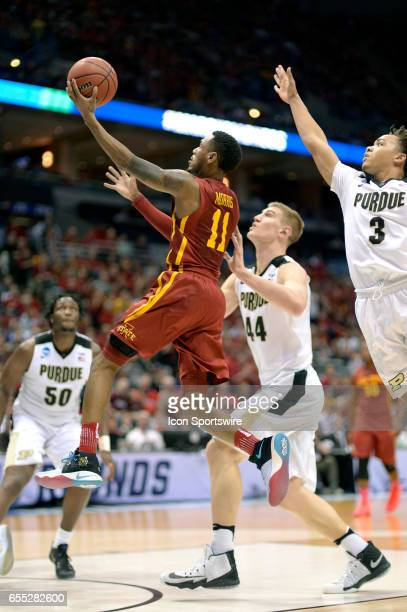 Iowa State Cyclones guard Monte Morris jumps past Purdue Boilermakers center Isaac Haas for a lay up attempt in the first half during the first round...