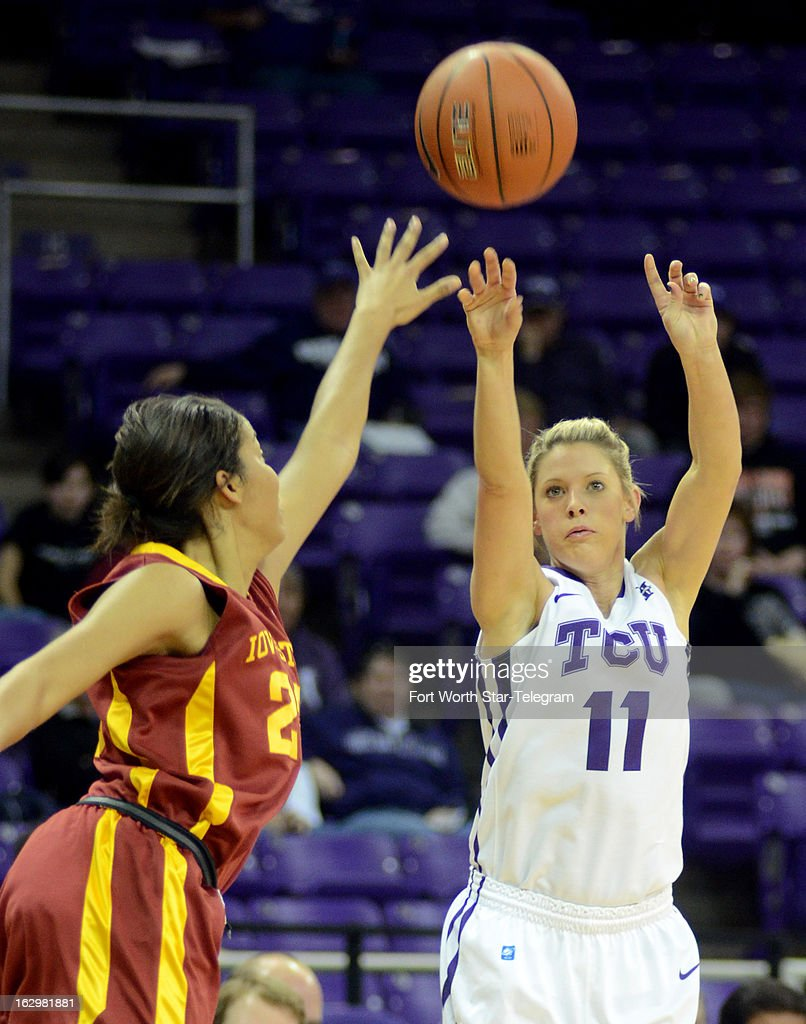 Iowa State's Brynn Williamson, left, tries to block the 3-point shot of Texas Christian's Kamy Cole (11) during the first half at the Daniel-Meyer Coliseum in Fort Worth, Texas, on Saturday, March 2, 2013. TCU won, 61-58.