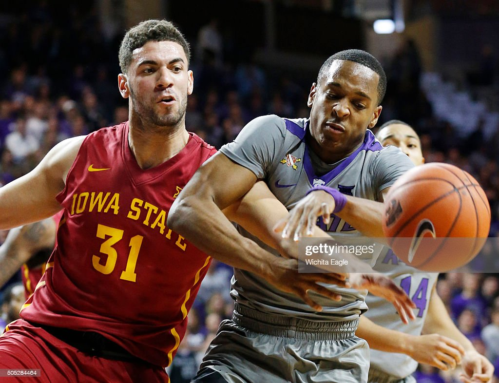 Iowa State's Georges Niang and Kansas State's Barry Brown battle for a rebound in the first half at Bramlage Coliseum in Manhattan Kan on Saturday...