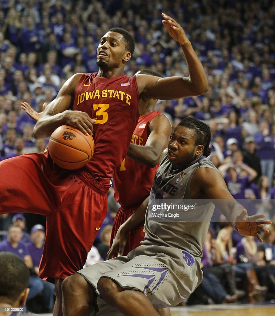 Iowa State's Melvin Ejim (3) falls back on Kansas State's D.J. Johnson as he pulls down a rebound at Bramlage Coliseum in Manhattan, Kansas, on Saturday, February 9, 2013. K-State defeated Iowa State, 79-70.