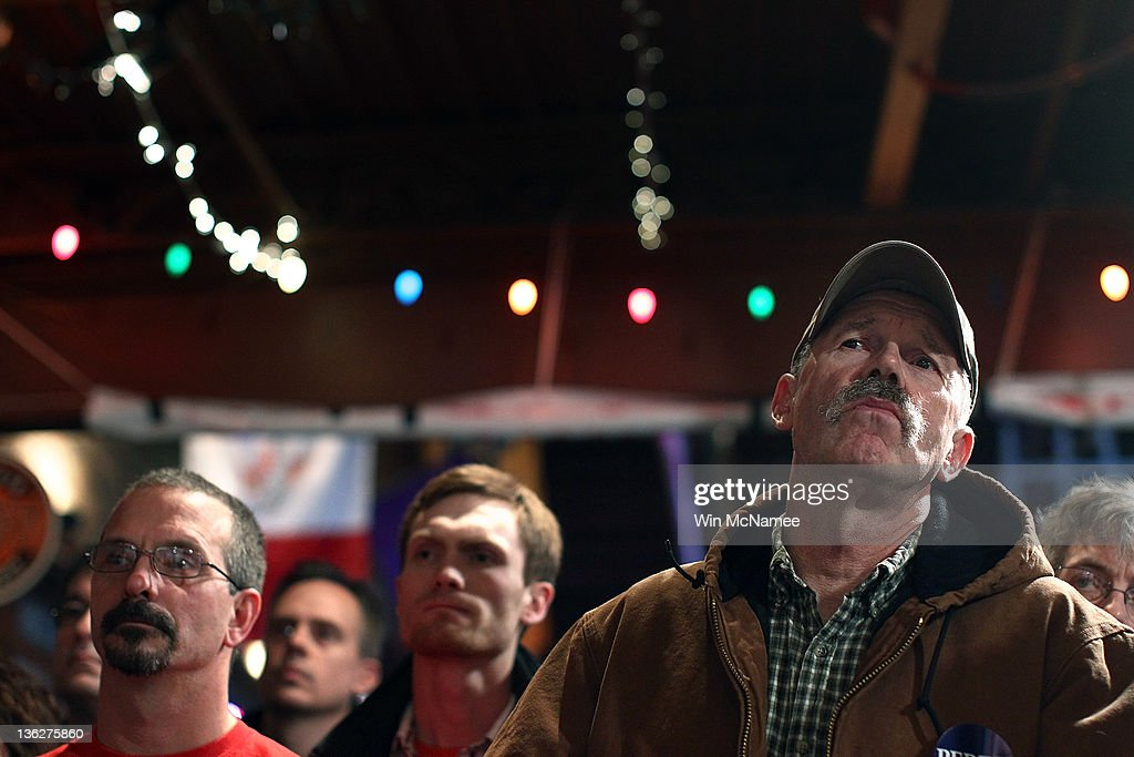 Iowa voters listen as Republican presidential candidate Texas Gov. Rick Perry speaks at The Fainting Goat bar and restaurant December 30, 2011 in Waverly, Iowa. Four full days of campaigning remain before Iowans vote on January 3rd.