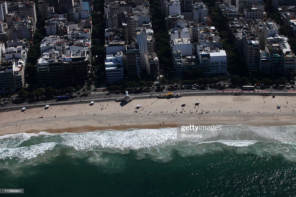 Ipanema Beach is seen in this aerial photograph of Rio de Janeiro, Brazil, on Thursday, July 4, 2013. Brazils shorter-term swap rates fell after a report showed inflation slowed in June more than analysts forecast, damping speculation that the central bank will increase borrowing costs at a faster pace. Photographer: Dado Galdieri/Bloomberg via Getty Images