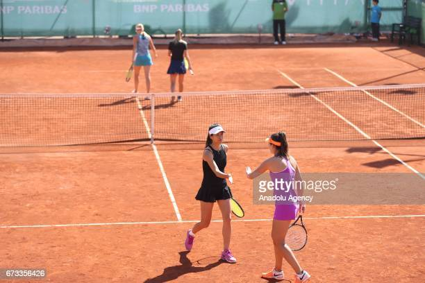 Ipek Soylu of Turkey and SuWei Hsieh of Taiwan in action against Dalila Jakupovic of Slovenia Nadia Kichenok of Ukraine during the TEB BNP Paribas...