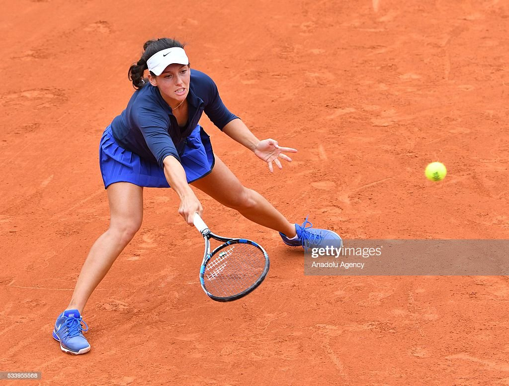 Ipek Soylu (C) of Turkey in action during women's single first round match against Virginie Razzano of France at the French Open tennis tournament at Roland Garros in Paris, France on May 24, 2016.