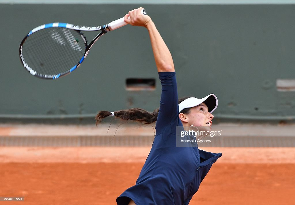 Ipek Soylu (C) of Turkey serves the ball during women's single first round match against Virginie Razzano of France at the French Open tennis tournament at Roland Garros in Paris, France on May 24, 2016.
