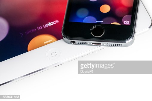 iPhone 5s on a white Apple iPad tablet : Stock Photo