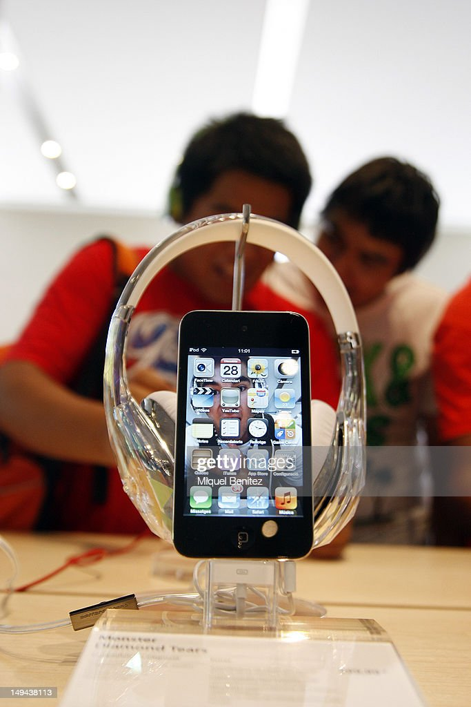 iPhone (smart phone) and headphones are diplayed during the opening of Apple's New Barcelona Store in Passeig de Gracia on July 28, 2012 in Barcelona, Spain.