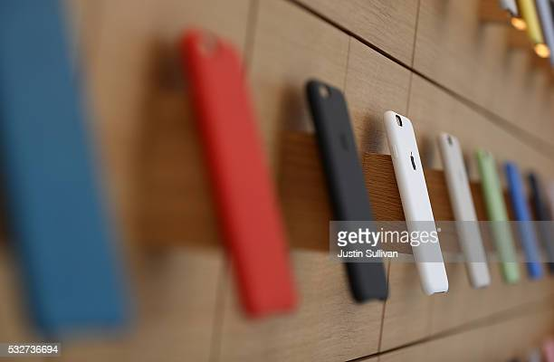 iPhone covers are displayed during a press preview of the new flagship Apple Store on May 19 2016 in San Francisco California Apple is preparing to...