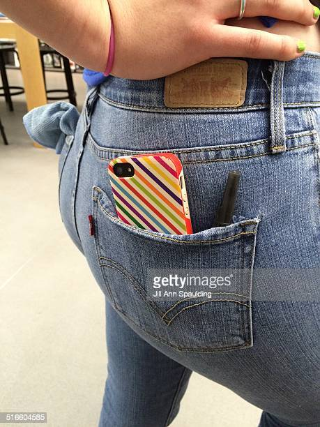 iPhone in back pocket of girls jeans