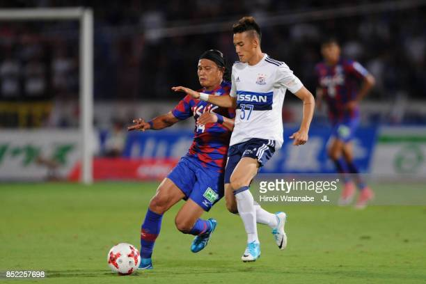 Ippei Shinozuka of Yokohama FMarinos and Yusuke Tanaka of Ventforet Kofu compete for the ball during the JLeague J1 match between Ventforet Kofu and...