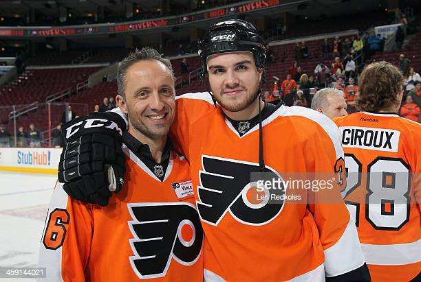 Ippolito Rinaldo the uncle of Zac Rinaldo of the Philadelphia Flyers pose for a photo following the father and son team photo after their game...