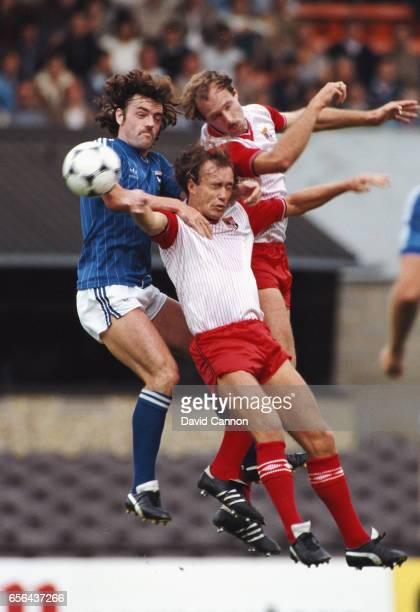 Ipswich player John Wark is challenged by Paul Dyson and Sammy McIlroy of Stoke during a League Division One match between Ipswich Town and Stoke...