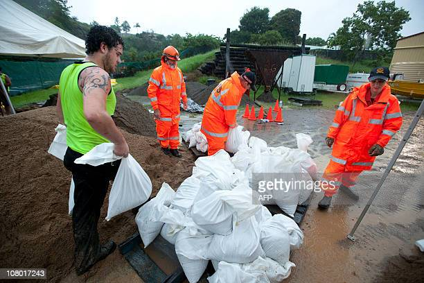 Ipswich State Emergency Service people ready sand bags amid expected heavy flooding in the area on January 11 2011 Thousands of people fled central...